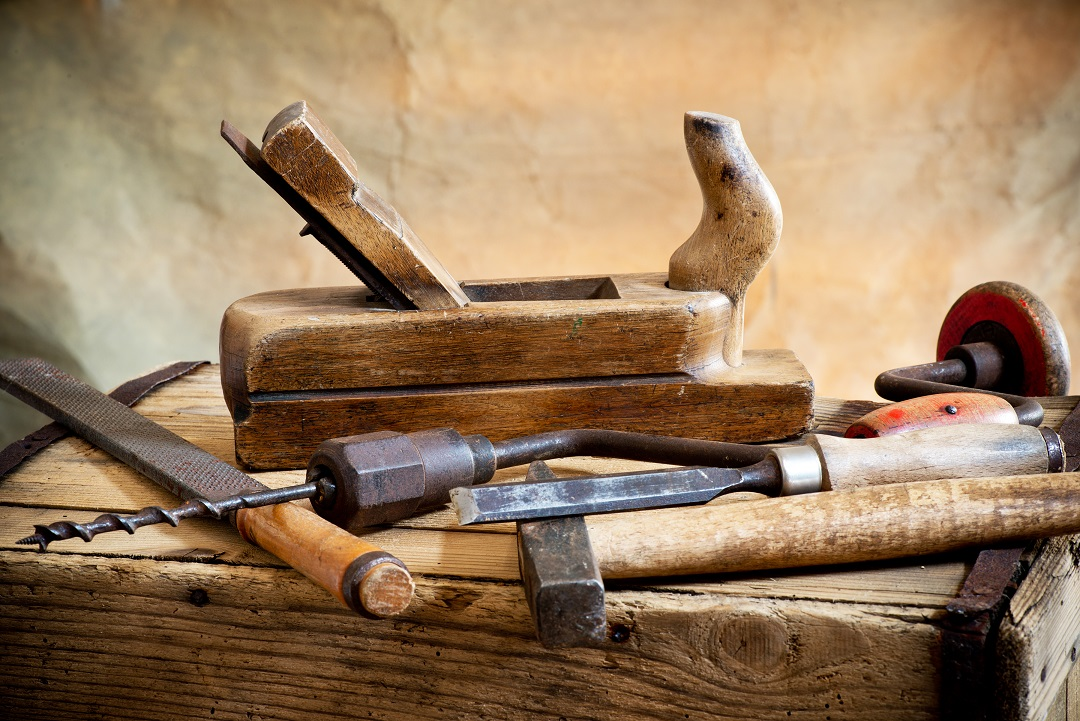still life with old hammer and carpentry tools